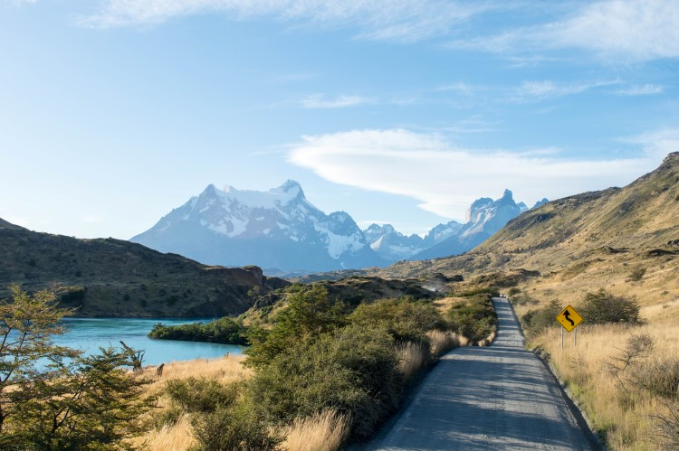 The paved road into Torres del Paine National Park from the south, facing the Los Cuernos mountins and a key destination to include in a Patagonia itinerary for one week or two weeks