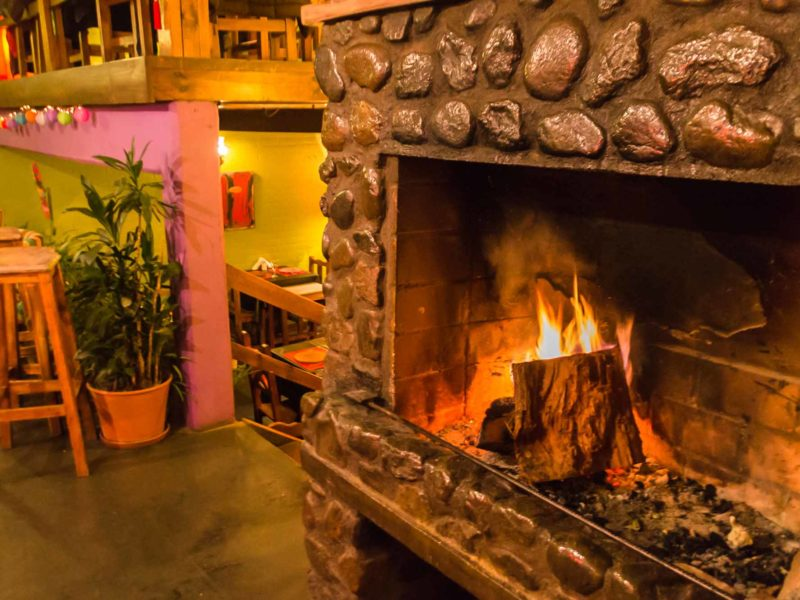 The wood fire at Pura Vida in El Calafate, a good spot for dinner in Argentinean Patagonia