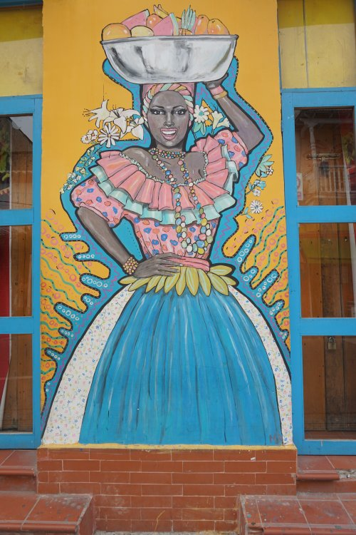 A street art mural of a palenquera or fruit vendors in Cartagena, Colombia.