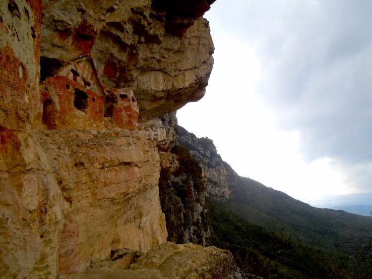The painted mausoleums of Revash perched in the cliff above the valley near Chachapoyas Peru