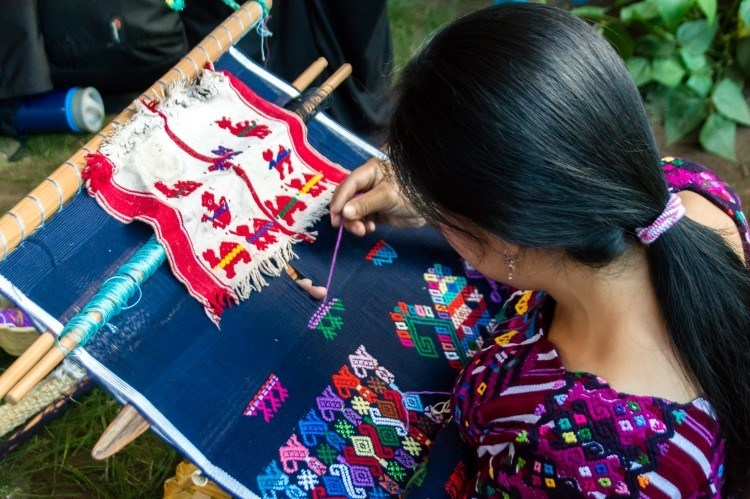 Weavers in Santo Domingo Xenacoj, a sustainable weaving community in Guatemala