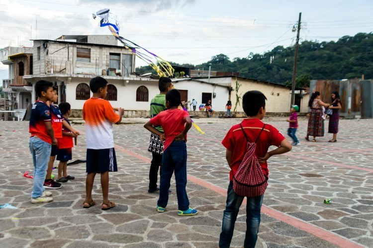 Kite flying in the main square of San Juan La Laguna, one of the towns on Lake Atitlan, Guatemala and filled with sustainable things to do and visit