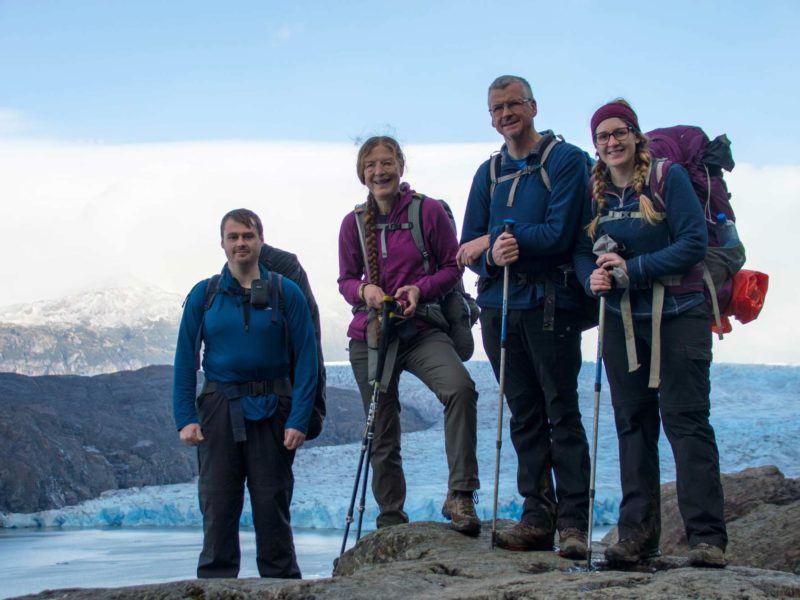 Four hikers pose in front of Glaciar Grey in Torres del Paine National Park, a must-visit destination for any Patagonia itinerary