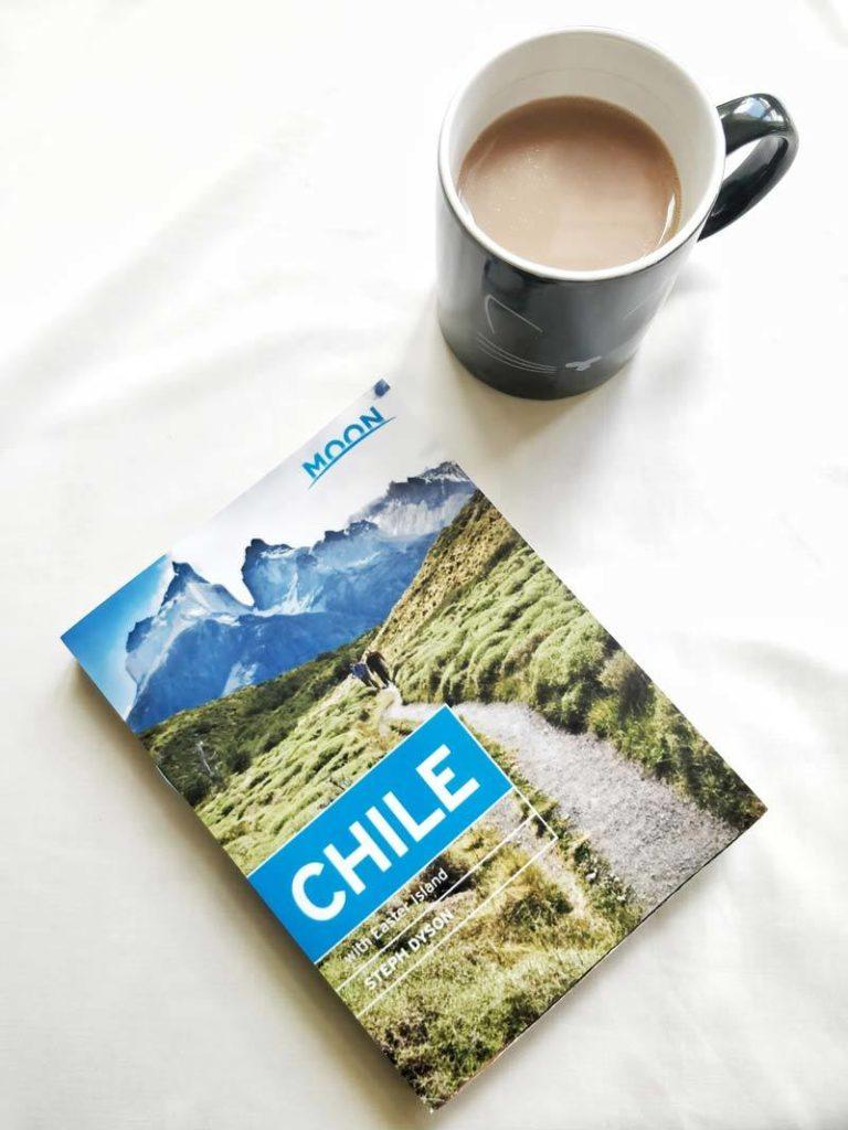 Moon Chile guidebook next to a cup of tea