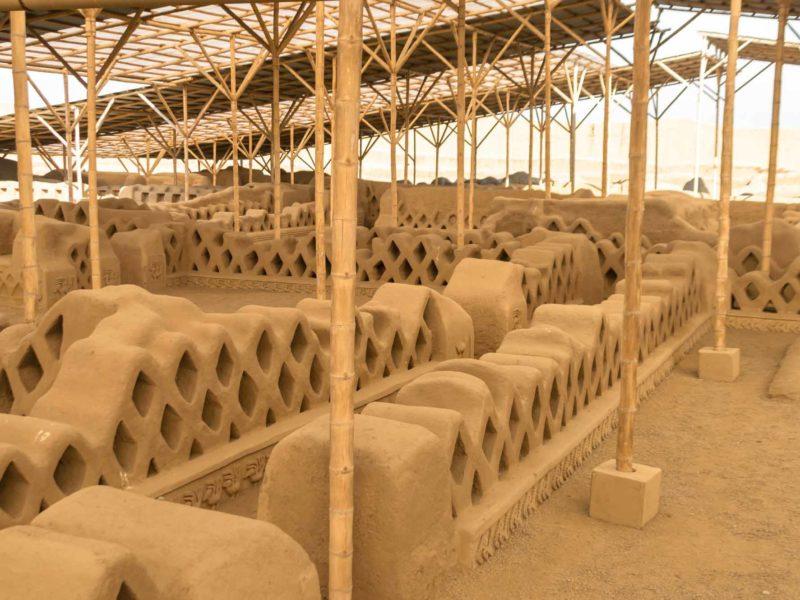 Rows of restored adobe walls in the Chan Chan complex, near Trujillo, Peru