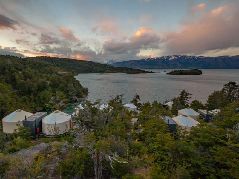 Views across Lago Toro and the Cuernos del Paine from above the glamping domes of Patagonia Camp, one of the top Torres del Paine hotels in Chilean Patagonia