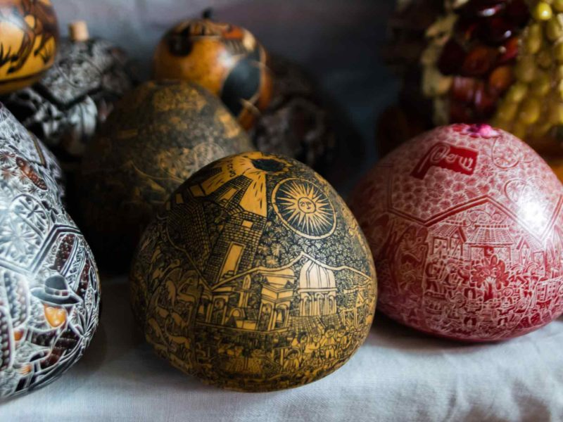 A carved gourd depicting scenes from Peruvian history in Cochas Grande near Huancayo, an unmissable place to visit in Peru