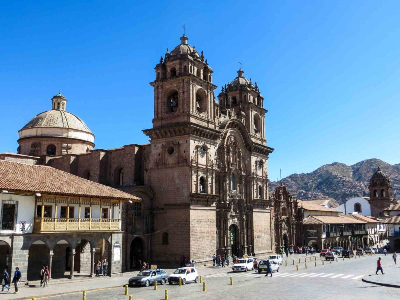 The Plaza de Armas in the historic core of Cusco and the Iglesia De La Compañia De Jesús, a church built by the Spanish and a central place to go on a trip to Peru