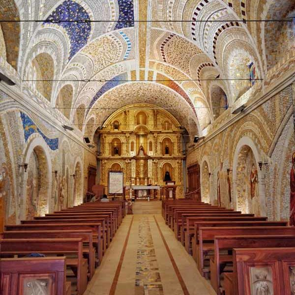 The glittering gold and coloured mosaics inside the Santuario de la Virgen de Polloc near Cajamarca and a completely unknown place to visit in Peru
