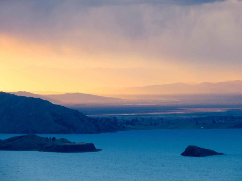 Sunset from Isla Amantani across Lago Titicaca, an unmissable place to visit in Peru