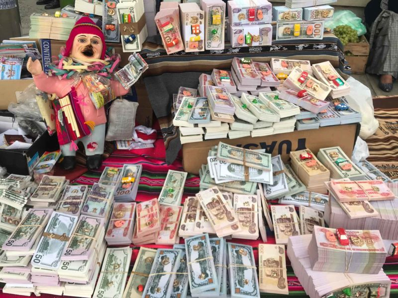 (Fake) money sold at market stalls during the Feria de las Alasitas, an important annual event for tourists and local alike in La Paz, Bolivia