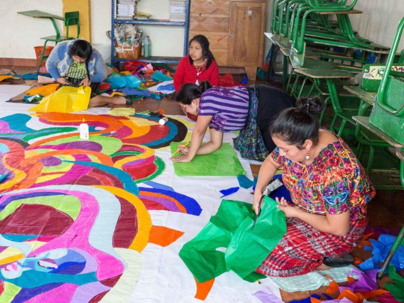 Women work on a kite for the Dia de los Muertos on November 1 in Santo Domingo Xenacoj