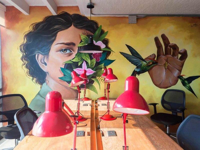 A mural painted above the desks in the Selina Lima coworking space.
