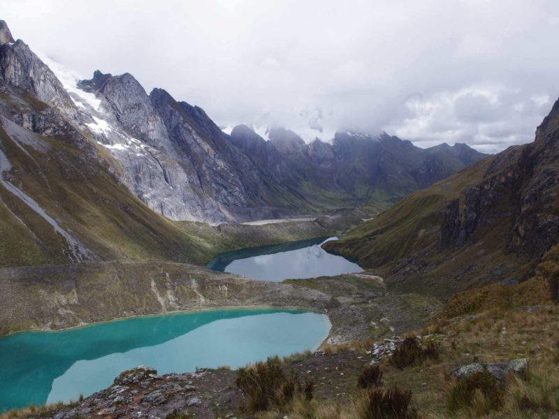 Glacial lakes overlook the long valley and mountain peaks of Cordillera Huayhuash in Peru. This region has some of the best treks in South America