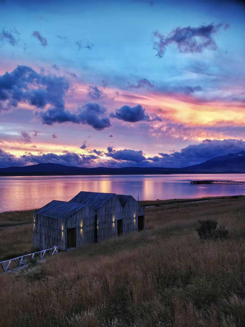 This purple sunset over Puerto Natales Chile is the perfect starting point for some of the Best South America Backpacking Routes