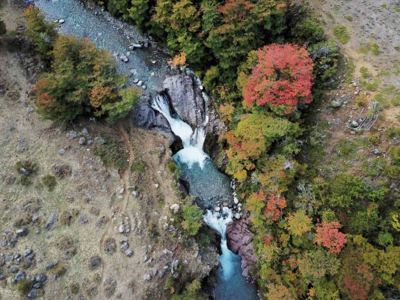 Aerial shot of a waterfall in Cerro Castillo National Park, along Chile's Carretera Austral