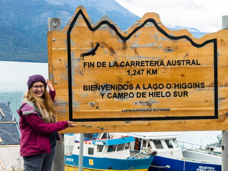 """Sign saying """"the end of the road"""" at the end of Patagonia's Carratera Austral near Villa O'Higgins"""