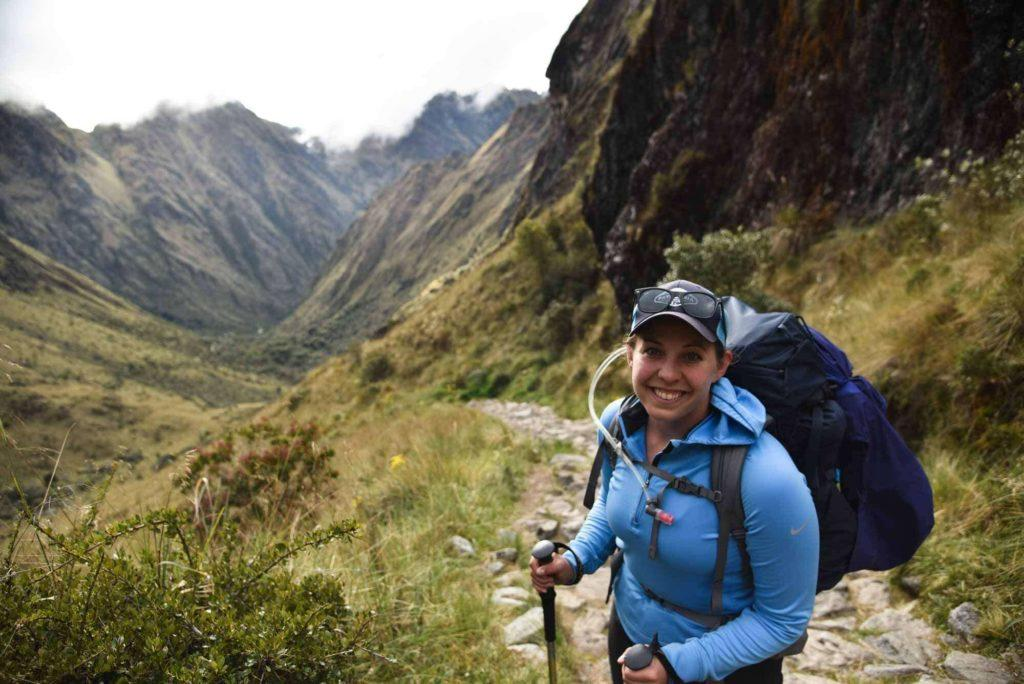 A hiker stands at the top of the Dead Woman's Pass on the inca trail