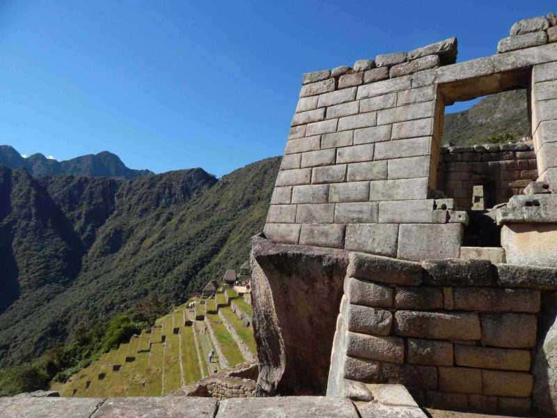 The Sun Gate with terraces in the background at Machu Picchu