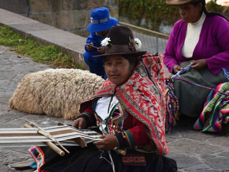 Traditional weavers in the city of Cuzco, Peru.