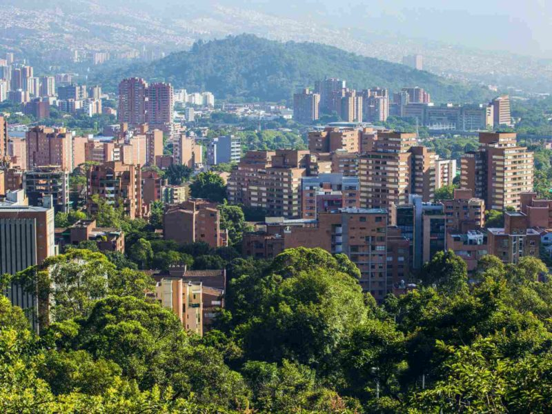 The buildings of Medellin Colombia among the trees.