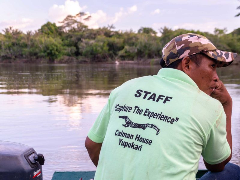 A staff member at Caiman House on an expedition to capture a caiman for scientific research in Guyana