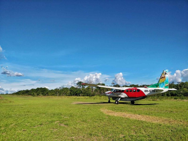 A light aircraft on a dirt runway in Guyana, South America