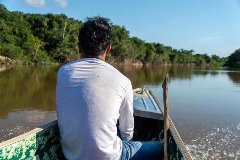 A boat glides down a river in Guyana, South America