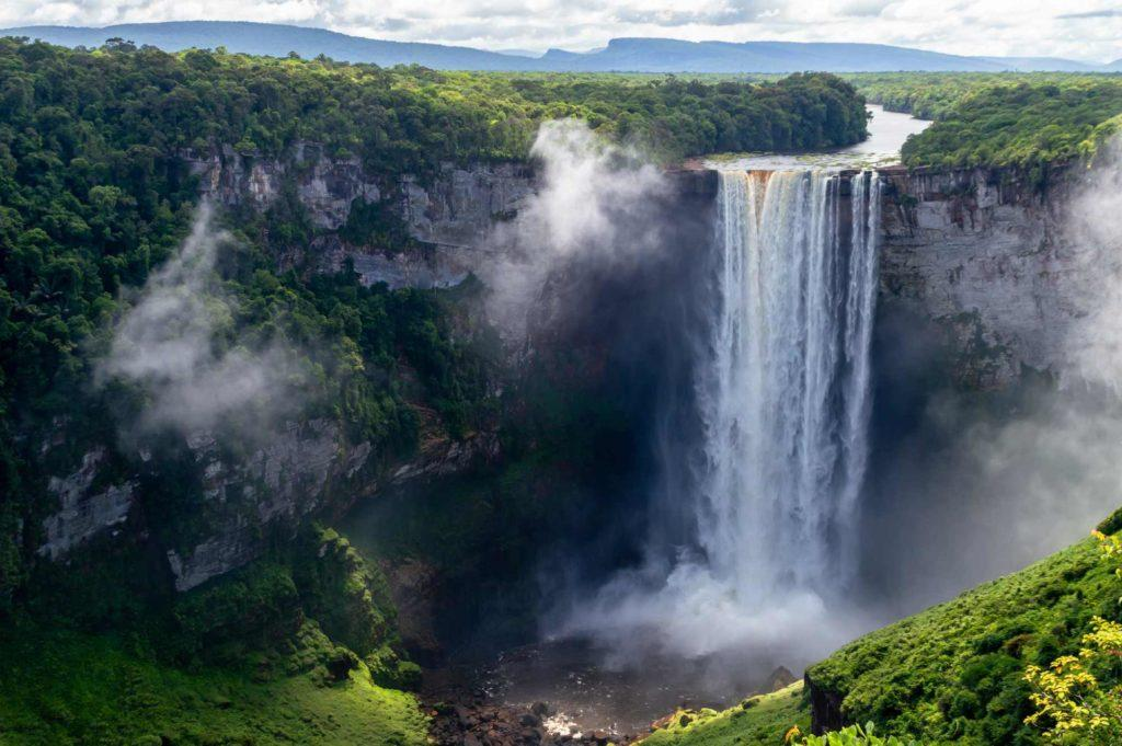 The Potaro River plunges over a cliff edge in the jungle, forming Kaieteur Falls - one of Guyana's most photogenic tourist attractions.
