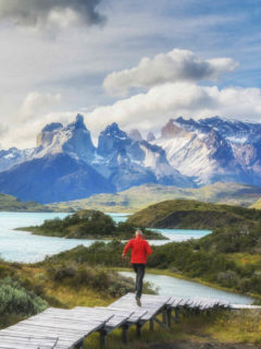 A person runs down a wooden boardwalk at the Salto Chico viewpoint in Torres del Paine National Park, a short day hike