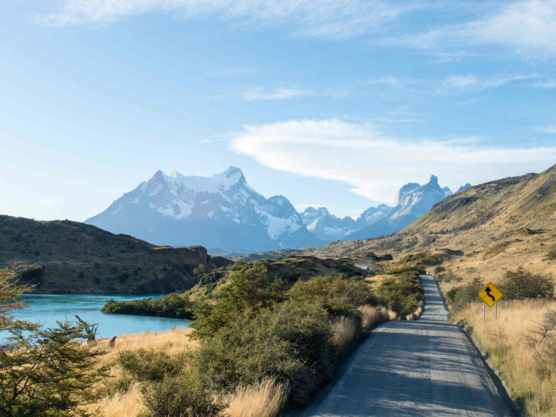 The open road in Torres del Paine National Park, Patagonia, with Los Cuernos in the background, an ideal place for day hikes in Patagonia