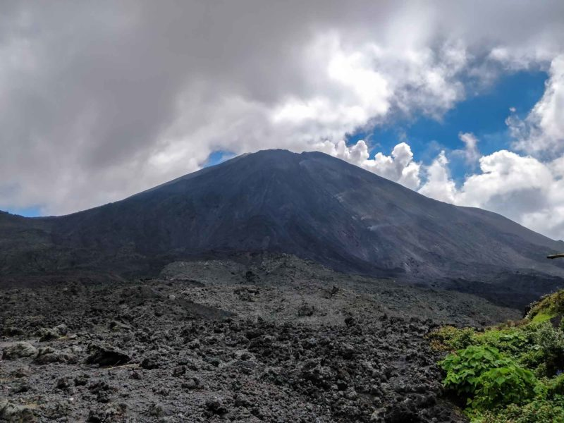 The crater of Volcan Pacaya rises out of the landscape of cooled lava