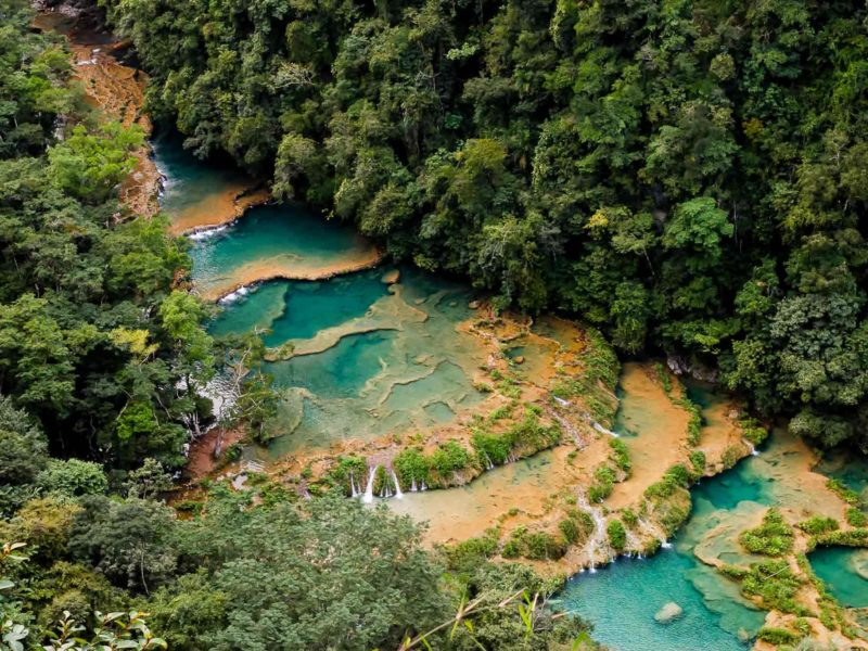 Semuc Champey, a series of tiered pools of water deep into the Guatemalan jungle and a must-visit destination on a Guatemala itinerary