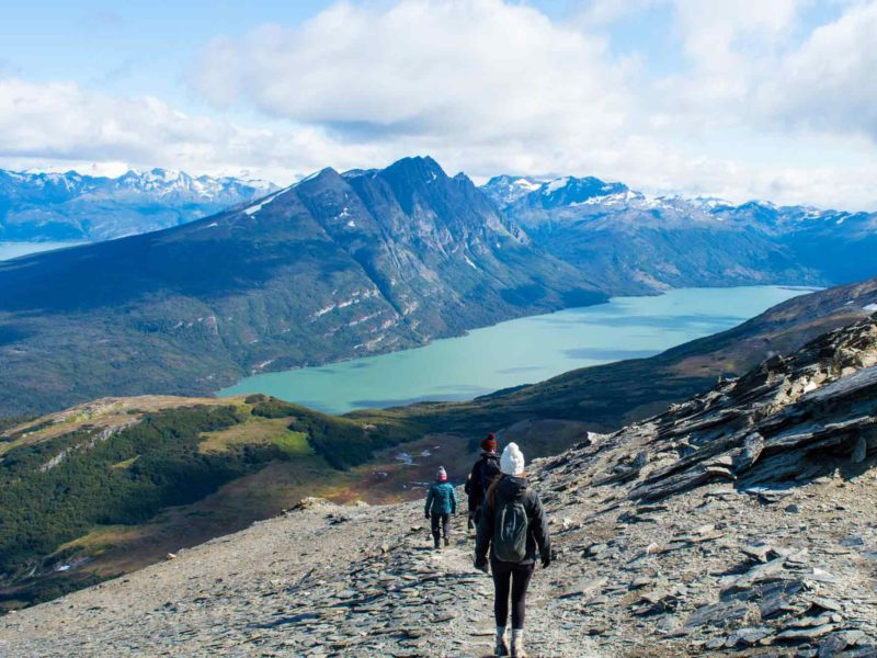 Hikers on the route down from Cerro Guanaco in Tierra del Fuego National Park, a hiking paradise in Argentine Patagonia