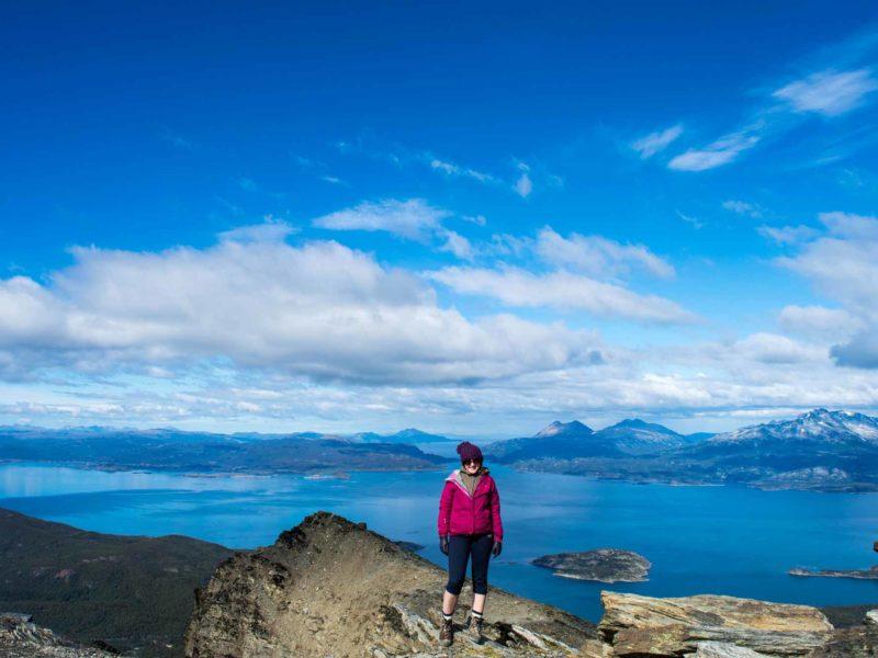 A person stands on a rock at the top of Cerro Guanaco in Parque Nacional Tierra del Fuego in Argentine Patagonia