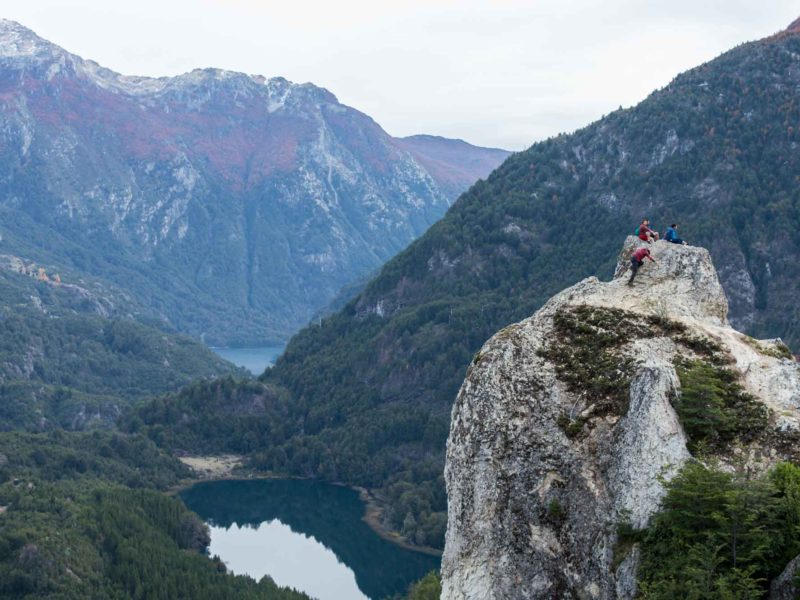 Hikers sat on the top of Piedra del Aguila near Futaleufu, a hike along the Carretera Austral in Chilean Patagonia