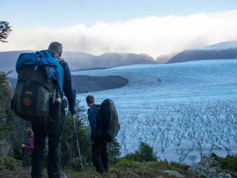 Hikers climb down from John Gardner Pass next to the Southern Patagonian Ice Field along the O Circuit in Torres del Paine National Park