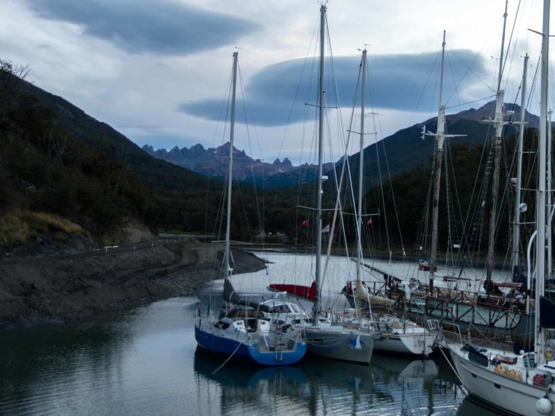 The Dientes de Navarino mountains behind yachts in the harbour in Puerto Williams, Chilean Patagonia