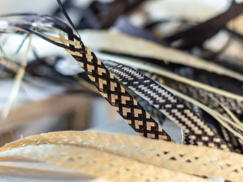 A braid woven from cana flecha in black and white in the community centre in 20 de Julio neighbourhood in Cartagena