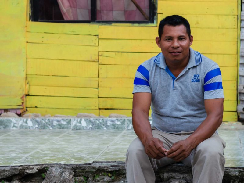 Wilfrido Perez Lucas, a Zenu indigenous leader in Cartagena, Colombia, sits on a step