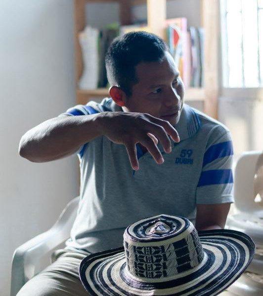 Wilfrido Perez Luca holds a sombrero vueltiao, a traditional Zenu and Colombian hat made from cana flecha