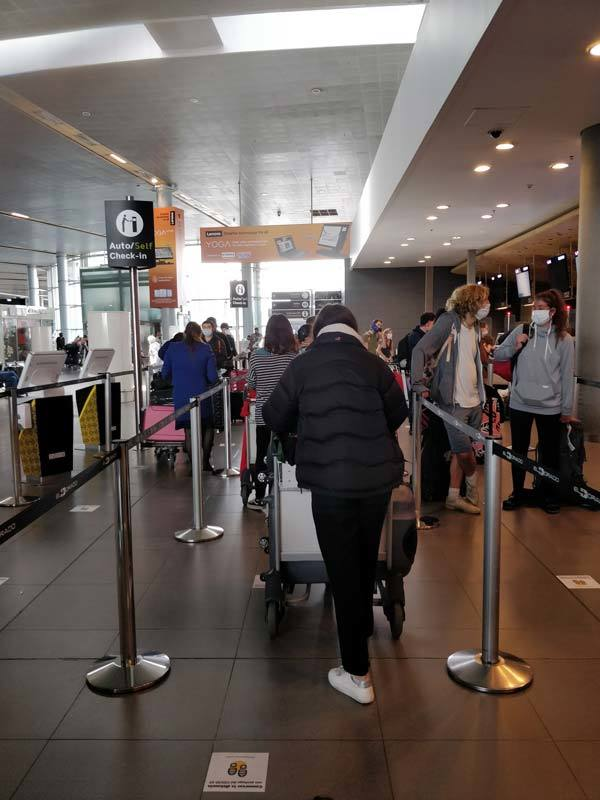 Travellers in a queue to check in for a repatriation flight to the UKat Bogota airport during the coronavirus crisis in South America