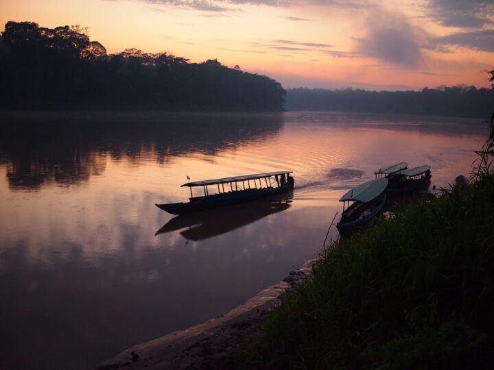 Sunrise over a river in the Amazon rainforest in Peru