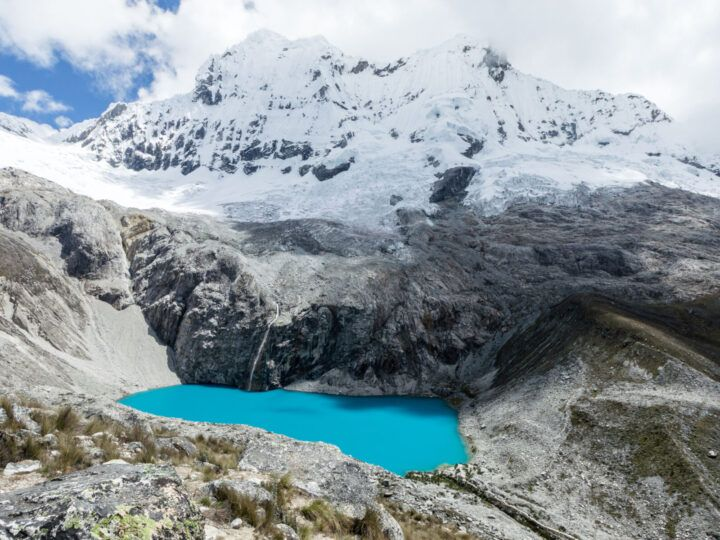 The electric blue waters of Laguna 69, Huaraz's most famous hike in the Cordillera Blanca